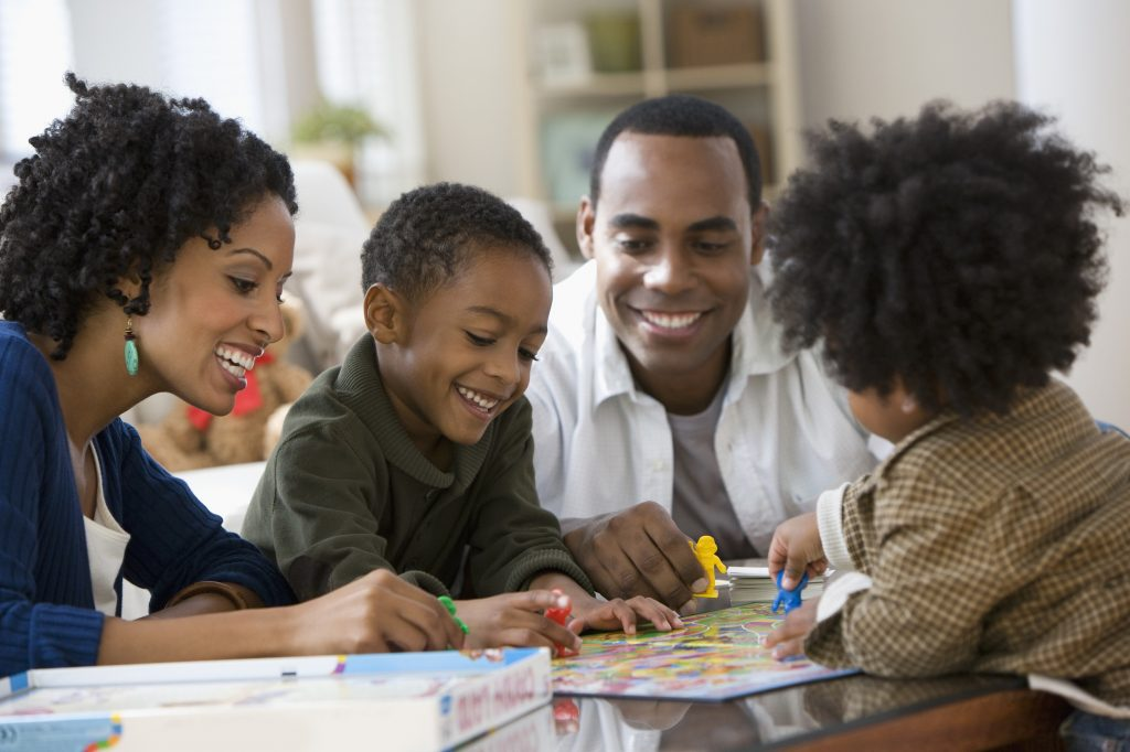 african-american-family-playing-board-game-together-1